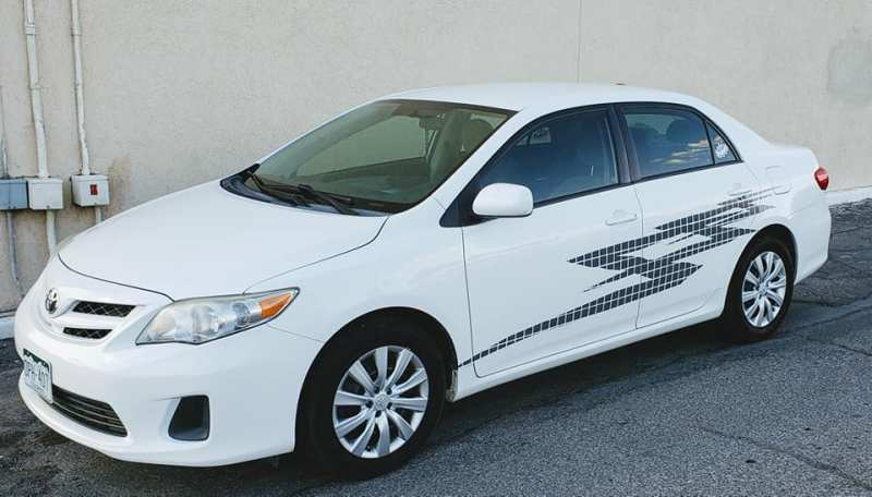 Photo of 2012 Toyota Corolla with custom vinyl graphics