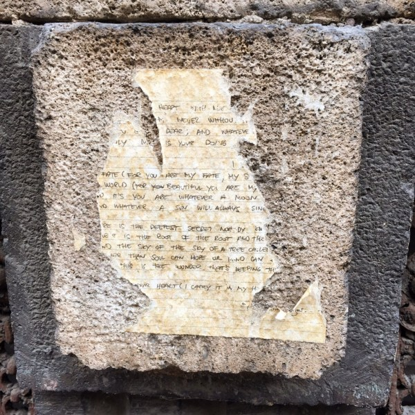 The nice thing about being somewhere new is, everywhere you look -- something new, like a love note weathered and torn asunder pasted to a random wall.
