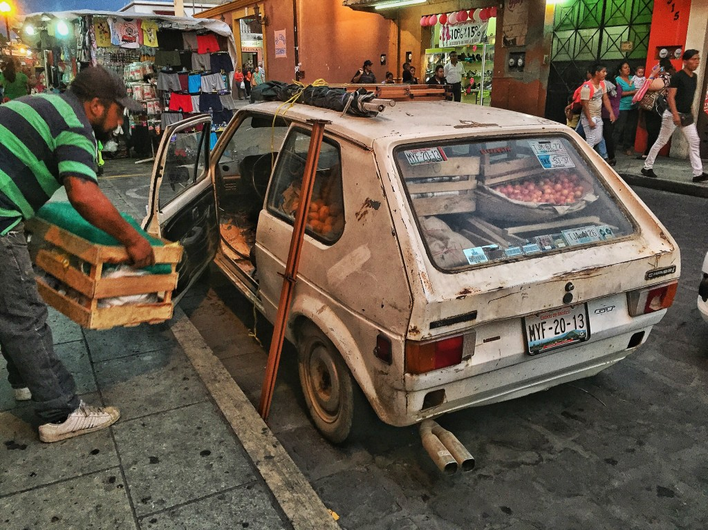But if I think I've got it hard, it's not even close to the life this guy lives. Here he is packing his car after a day of selling goods on the street.