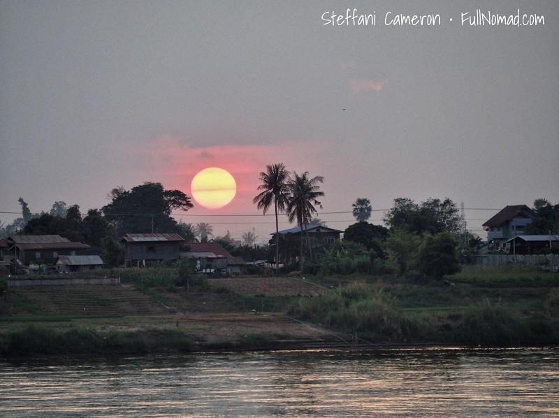 Strange eerie box-like sunset over the Mekong River