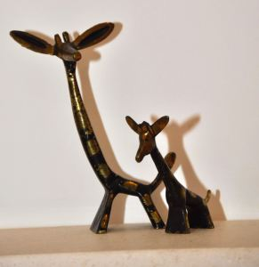 The need, in adolescence, for the self to develop independently, whilst at the same time, needing careful guidance to navigate tumultuous change, is represented here by the angles at which the giraffes stand in relation to each other.