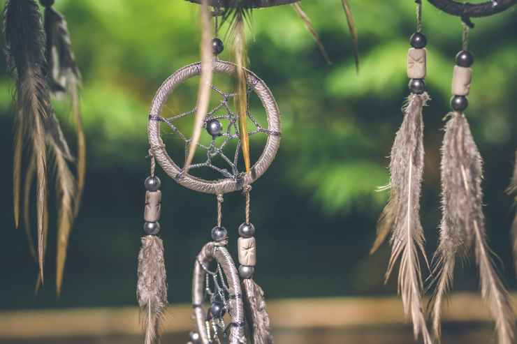selective focus photo of gray and black dream catcher