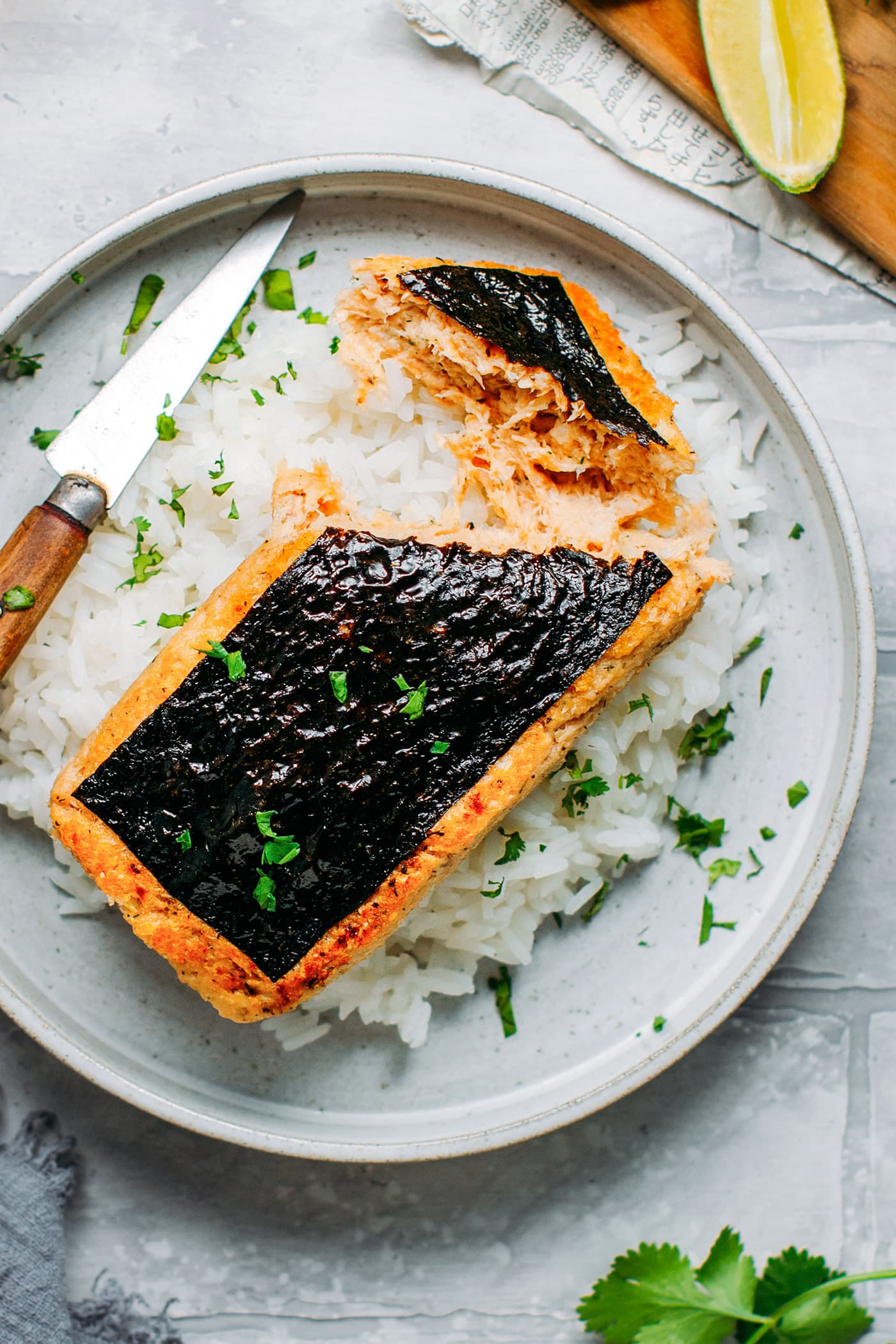 Vegan Fish Fillet on a bed of rice with cilantro.