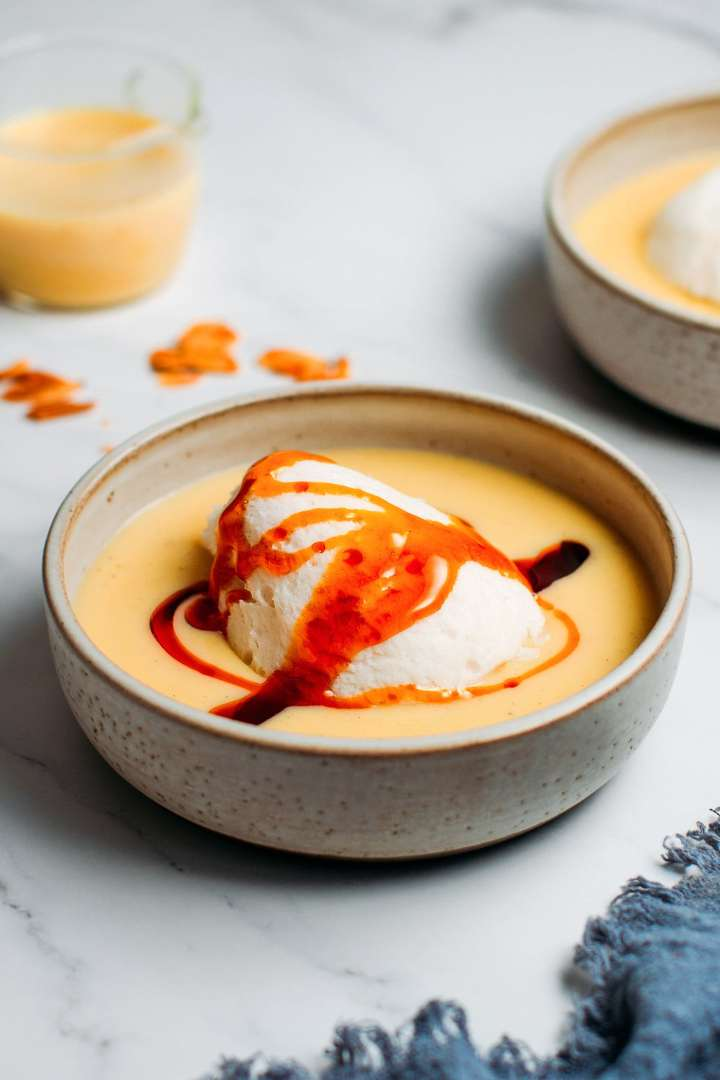 Vegan Île Flottante with a drizzle of caramel syrup
