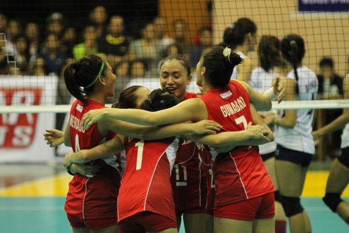 Air Asia players celebrate a point.