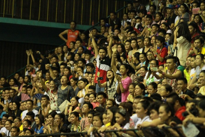 The jam-packed crowd at the USC Gym.
