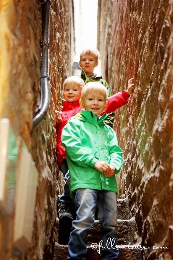 Kids exploring narrow streets at Mont Saint Michel