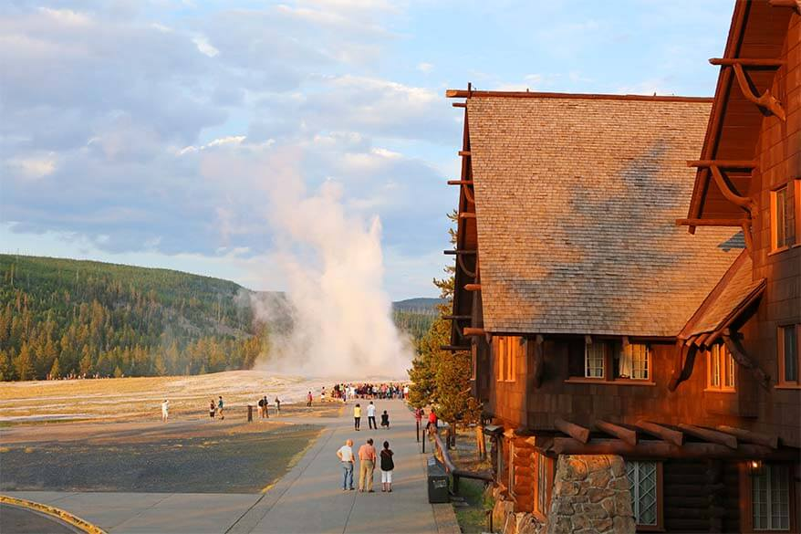 Old Faithful Inn and Geyser in Yellowstone National Park