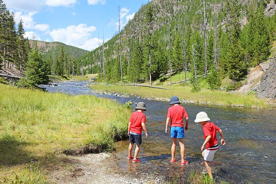 Kids playing in Gardner river in Yellowstone