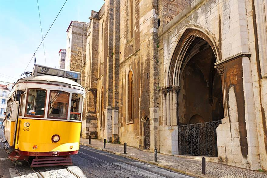 Famous Lisbon tram 28 passing the Se Cathedral