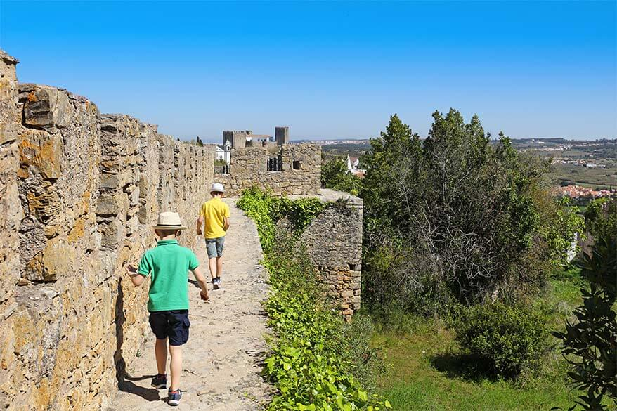 Walking on the city walls of Obidos in Portugal with kids