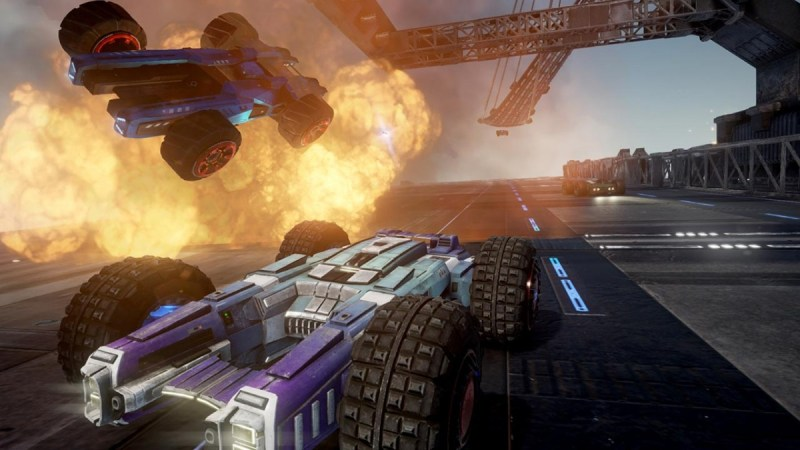 GRIP Combat Racing showing a car being flung into the air following an explosiong with another vehicle racing off