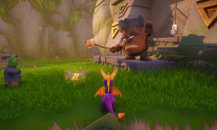 Spyro Reignited Trilogy gameplay with Spyro and Sparks the dragonfly in view staring toward an enemy