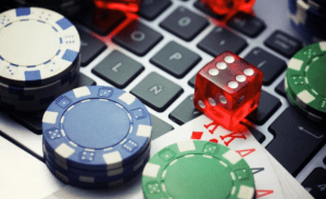Online Casino Games poker chips and dice on laptop