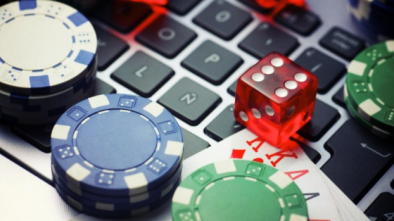 Online Casino poker chips and dice on laptop