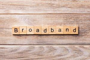 Broadband spelt out in small wooden tiles with letters on