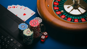 Casino roulette wheel, chips, cards and dice used in real casinos