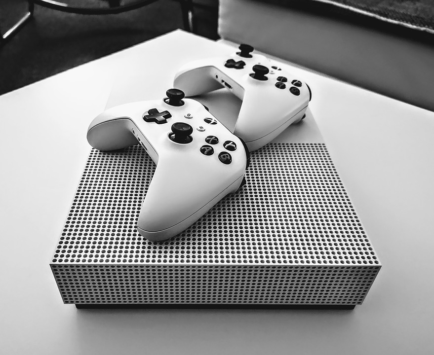 Xbox One X with two controllers