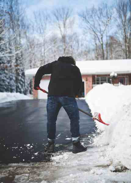 man is cleaning a snow