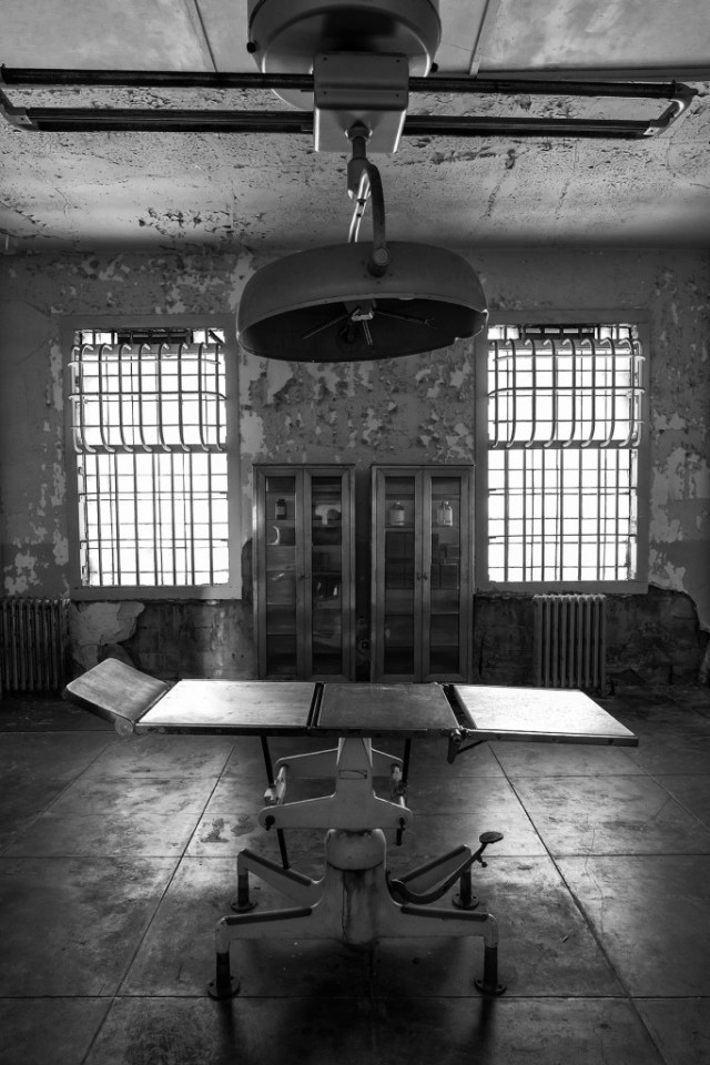black and white photograph of old fashioned hospital operating room at Alcatraz