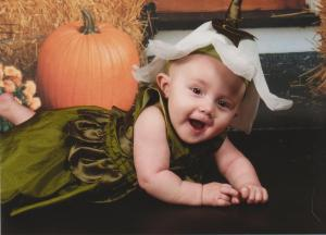 baby girl in a lily-of-the-valley Halloween costume
