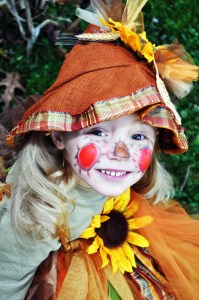 toddler girl in a scarecrow Halloween costume