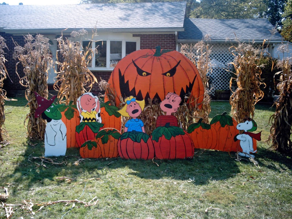 Charlie Brown Halloween yard decorations featuring a scary Great Pumpkin in a pumpkin patch, surrounded by cornstalks