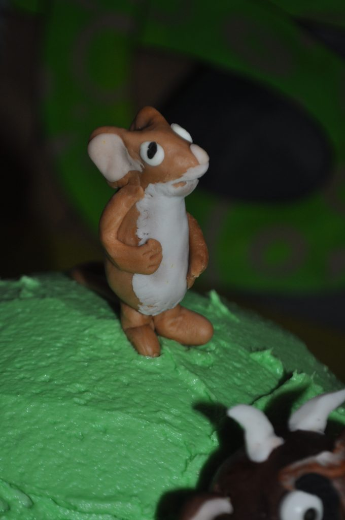 close up of the mouse character on top of a birthday cake
