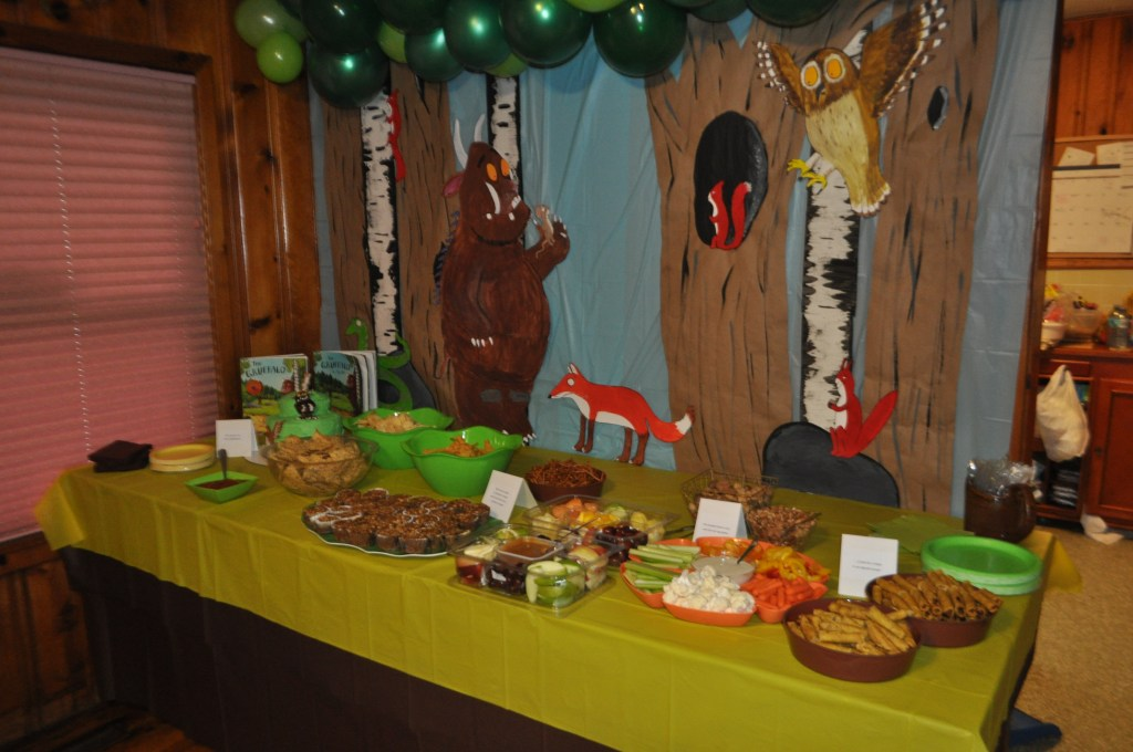 The Gruffalo themed birthday party food table with backdrop from the book and movie