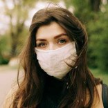 shallow focus photo of woman wearing face mask