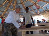Working one of the many table/bench combos we built led by our construction engineer Everett Rawlings and the help of the Haitian students