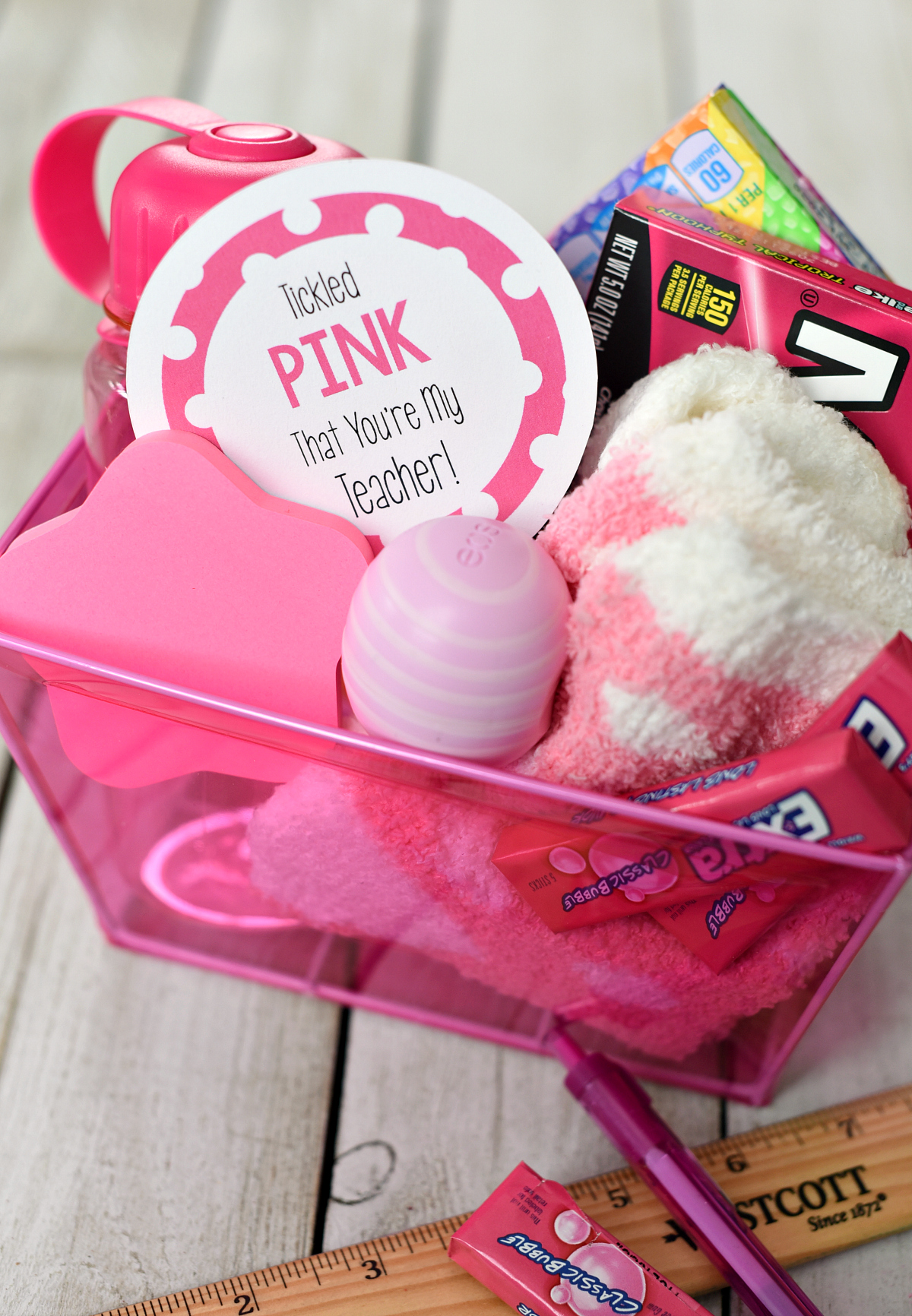 """Cute """"Tickled Pink"""" Teacher Gifts-Fill a gift basket with pink things and add this cute tag and you've got the best gift for a teacher! #teacherappreciation #teachergifts #teachergiftsendofyear"""