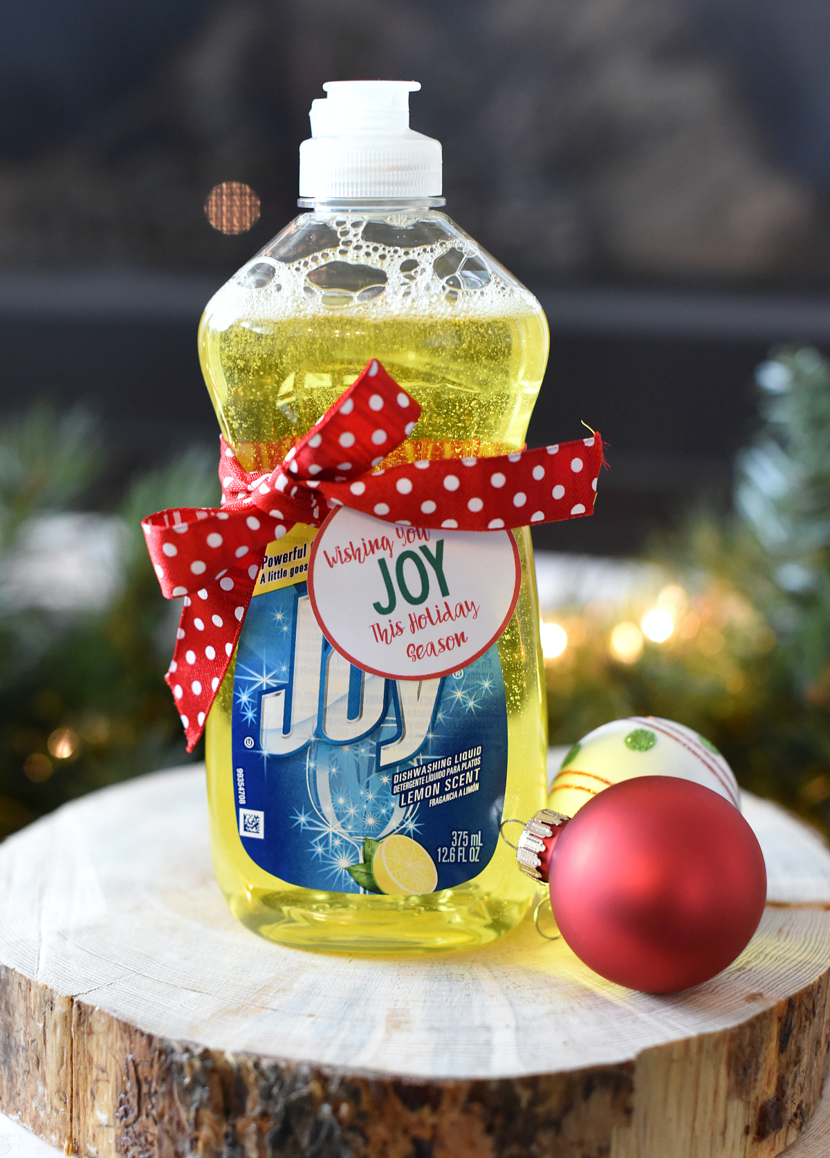 Wishing You JOY This Holiday Season-this easy neighbor gift is perfect. Add a tag to a bottle of Joy dish soap and you've got a fun, punny and useful neighbor gift. #christmas #giftideas #neighborgifts