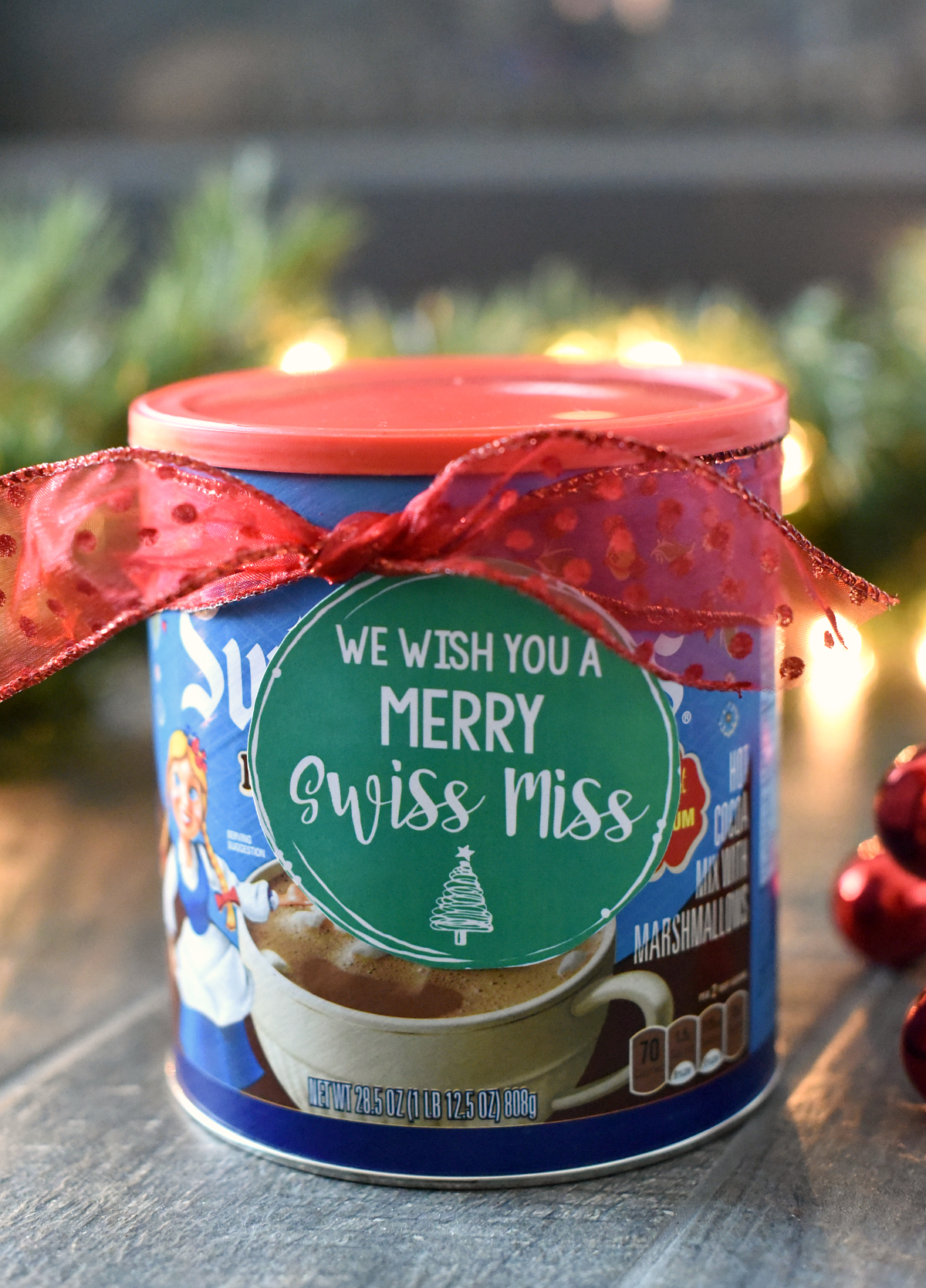 We Wish You a Merry Christmas Gift Idea-Add this cute tag to a package of hot chocolate and you've got a cute, easy and fun neighbor gift idea! #christmas #christmasgift #neighborgifts