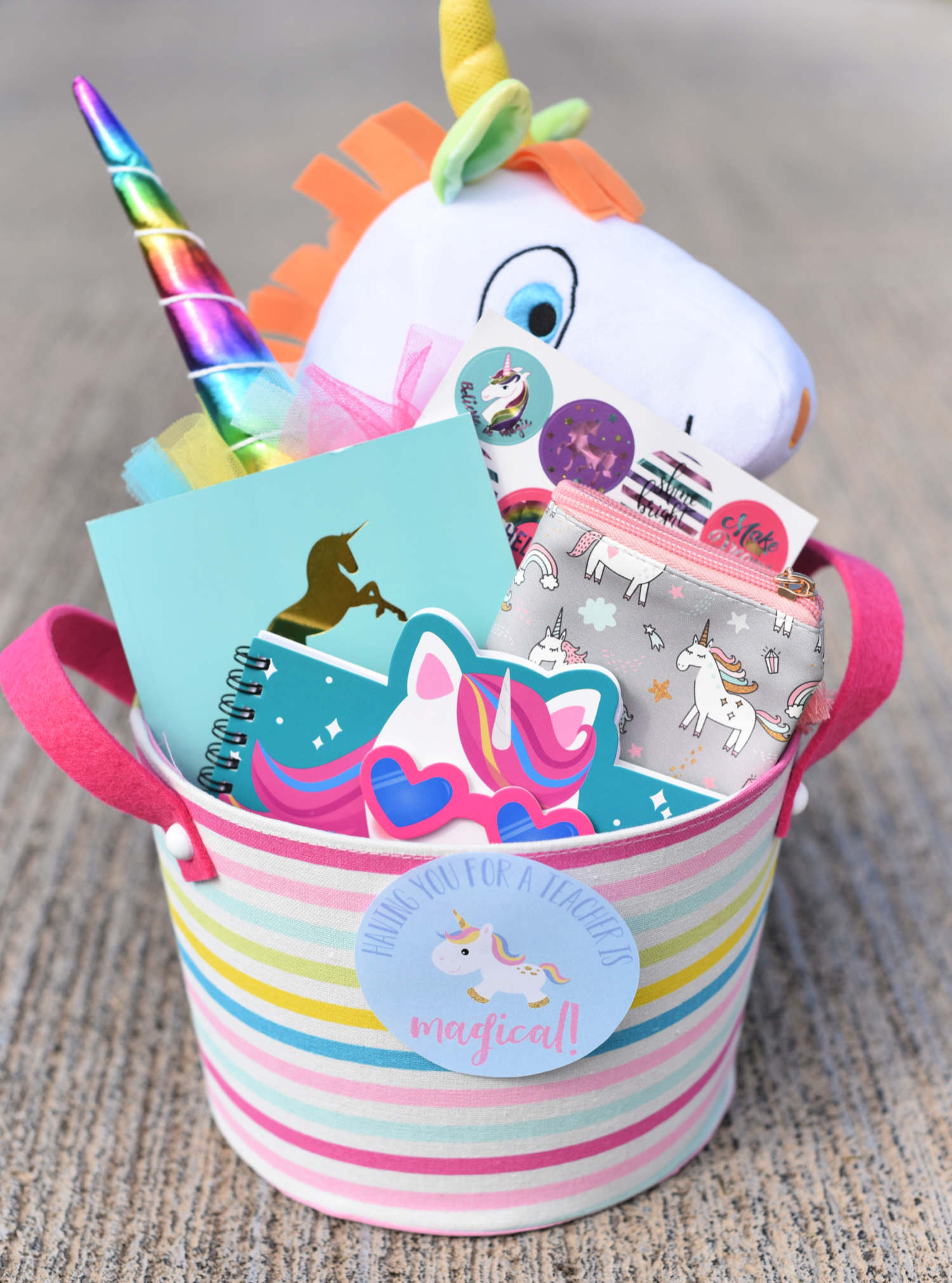 Unicorn Themed Teacher Gift Idea for teacher appreciation, holidays, her birthday, back to school or any occasion! Fill a basket with unicorn themed items and print this cute tag for a magical gift. #unicorns #teacherappreciation #teachergifts #teacherappreciationweek