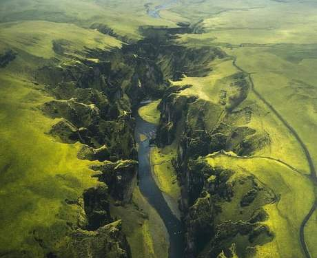 An aerial view of the Fjaðrárgljúfur, a massive canyon in Iceland