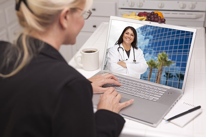 Woman Laptop Online Chat with Doctor