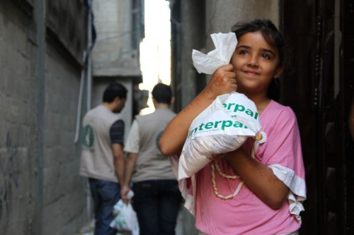 A Palestinian girl receiving Qurbani meat from Interpal