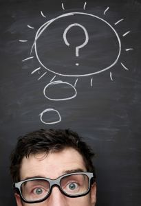 Image of a person with a question mark on a chalkboard