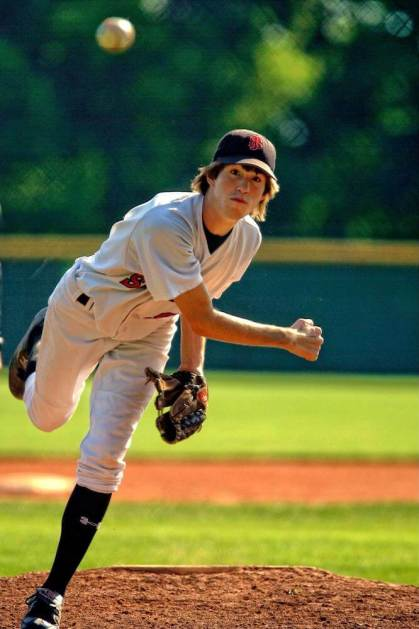 High School pitcher throws the ball