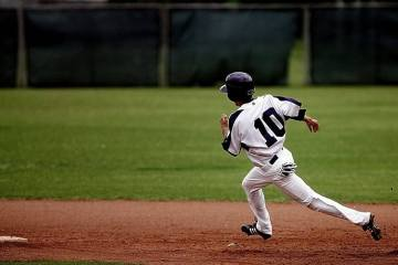 a baseball player running in the field