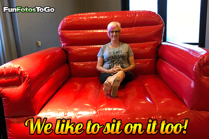 Fun Fotos To Go owner Kim, sitting in big red chair
