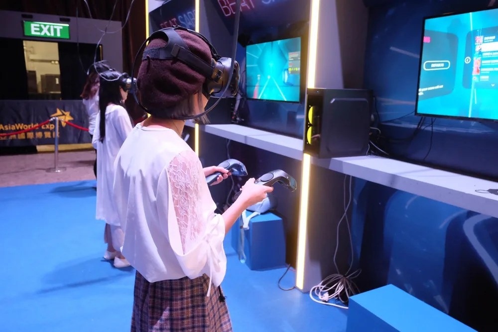 Visitors playing Beat Saber