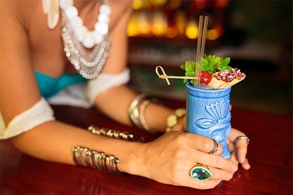Girl with Tiki Drink in the Hidden Gem of San Diego, The Grass Skirt