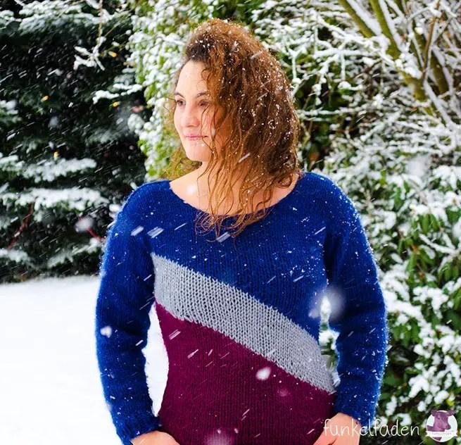 Kuschliger Strickpullover und Schnee