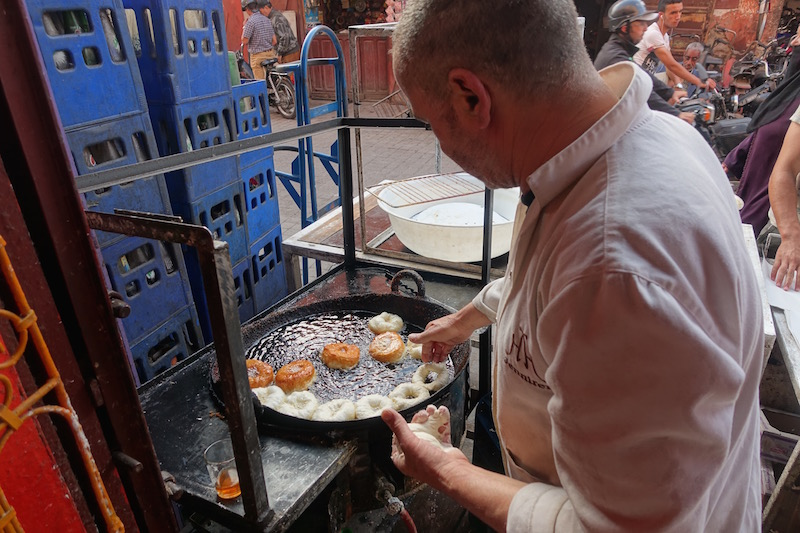 making sfinge savory donuts Marrakech food tour