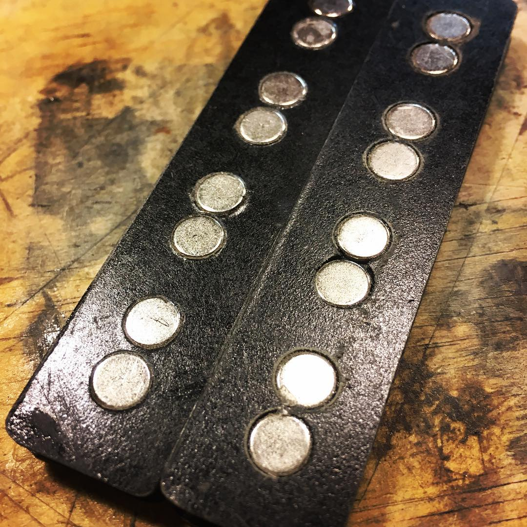 Complete Bobbins • these flanges were made with .030″ Garolite. Garolite is strong but is hard to cut and seems to chip easily. I'm going to use FR4 instead. #guitarpickups #neodymiummagnets #madscientist #basspickups #handwoundpickups #funktronicpickups