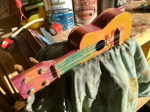 Toy guitar being repaired in the shop