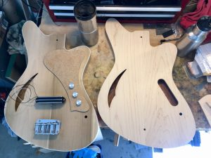two Sirena Modelo Uno bass bodies