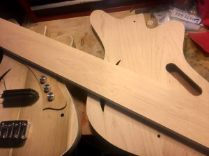 two Sirena Modelo Uno bass bodies and a neck blank